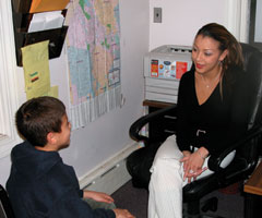 Counselor working with child