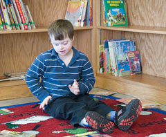A boy sitting in the library